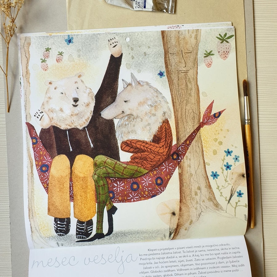 A page in Magic Tree picture book depicting a bear and a wolf in a hammock