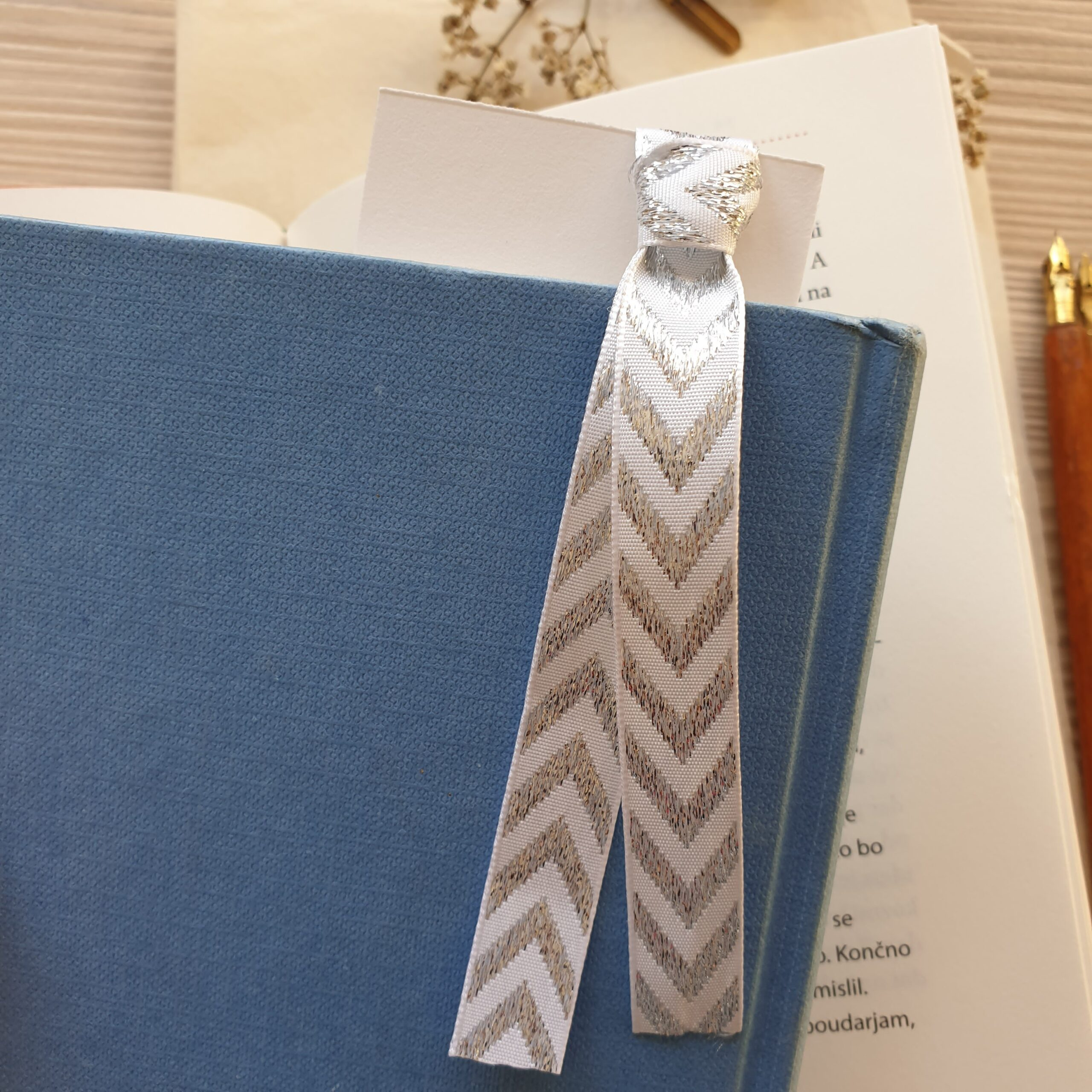 Floral bookmark in a book, silver